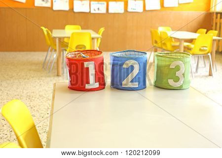 Three Containers For Toys With Numbers One Two Three In A Class