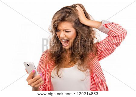 Shocked Frustrated Young Woman Holding Phone And Screaming