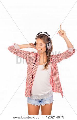 Cheerful  Pretty Girl Listening Music In Headphones And Dancing