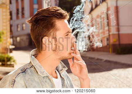 Close Up, Side View Portrait Of Handsome Man Smoking Cigarette