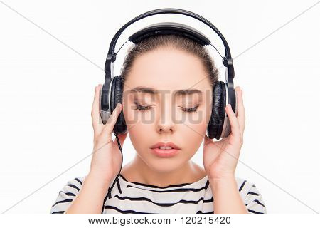 Calm Relaxed Young Woman With Headphones And Closed Eyes