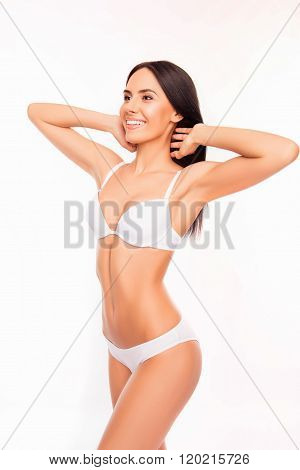 Beautiful Woman Showing Her Tan Slim Body On White Background