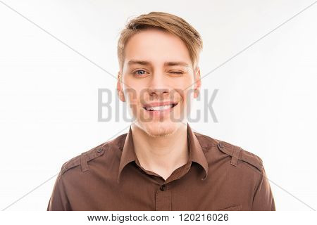 Close Up Portrait Of Handsome Cheerful Man Winking