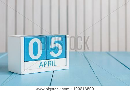 April 5th. Image of april 5 wooden color calendar on white background.  Spring day, empty space for