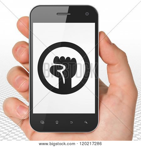 Politics concept: Hand Holding Smartphone with Uprising on display