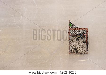 Ice Hockey Goal With Copy Space On Ice Skating Rink Texture Background