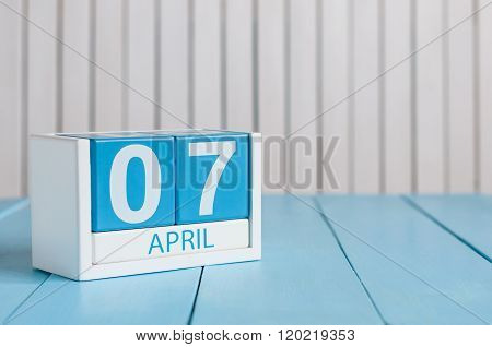 April 7th. Image of april 7 wooden color calendar on white background.  Spring day, empty space for