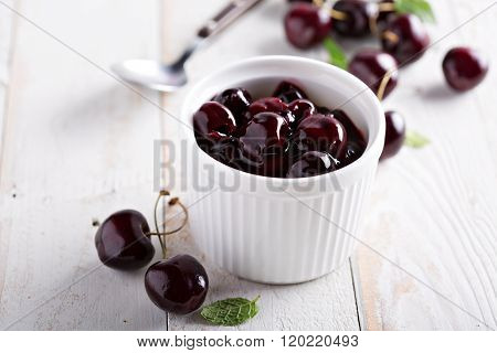 Homemade cherry sauce in white ramekin