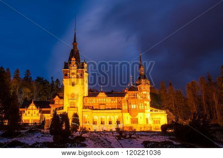 Famous Peles castle of Sinaia, illuminated at night in winter season, Romania