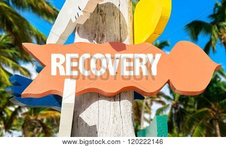 Recovery signpost with palm trees