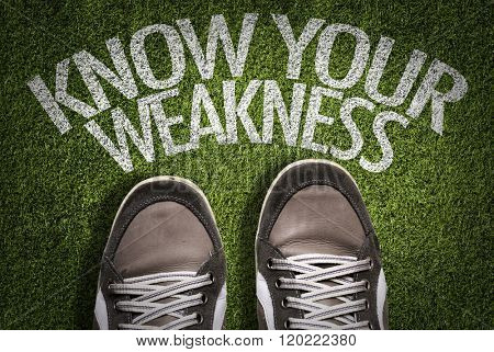 Top View of Sneakers on the grass with the text: Know Your Weakness