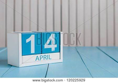 April 14th. Image of april 14 wooden color calendar on white background.  Spring day, empty space fo