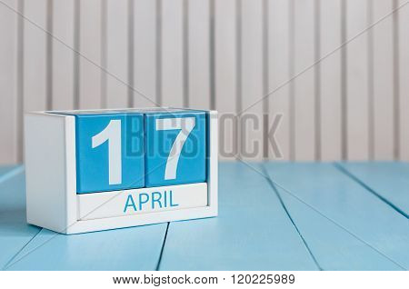 April 17th. Image of april 17 wooden color calendar on white background.  Spring day, empty space fo