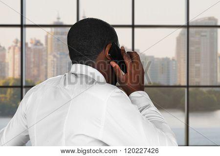 Phonetalk next to a window.