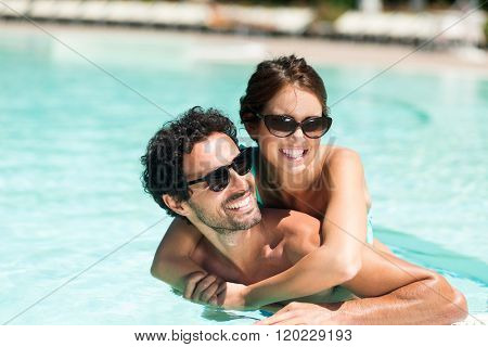 Couple having fun in a swimming pool
