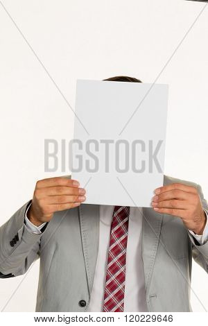 manager holding blank sheet in front of face
