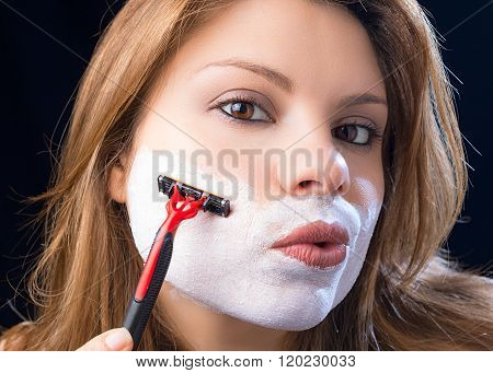 woman shaves beard
