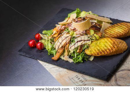 Caesars Salad On Black Background