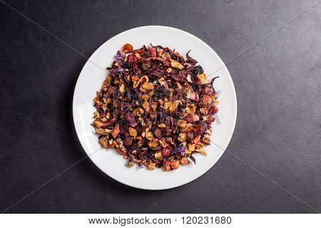 Fruit Garden Tea On White Plate On Dark Backgroung