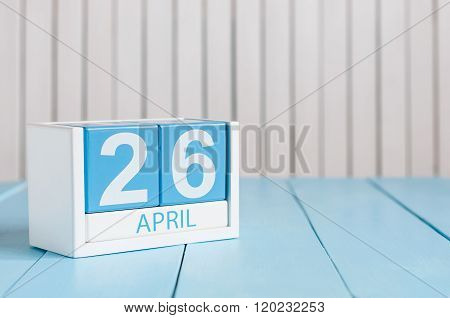 April 26th. Image of april 26 wooden color calendar on white background.  Spring day, empty space fo