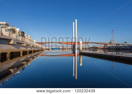 Bolte Bridge And Large Cargo Ship From Docklands Waterfront