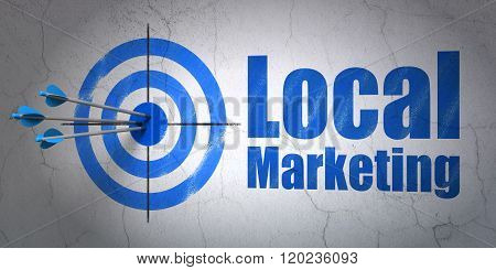 Advertising concept: target and Local Marketing on wall background