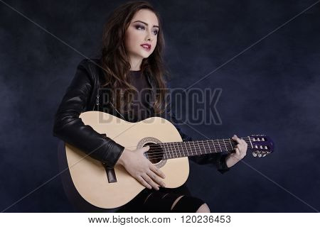 Young Teenage Girl Playing On Guitar.