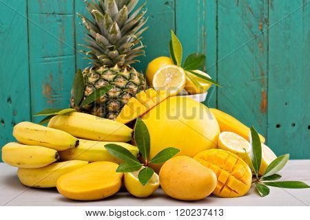 Variety of tropical fruit on bright background