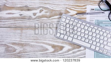 Faded White Desktop With Tax Form And Office Objects