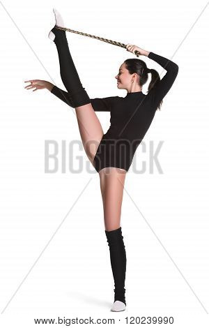 young sporty woman doing acrobatic exercise