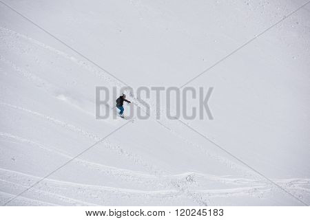 extreme freeride skier skiing on fresh powder snow in downhill at winter mountains