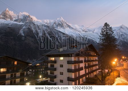 French alps mountain peaks covered with fresh snow. Winter landscape nature scene on night.