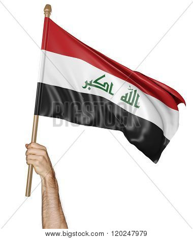 Hand proudly waving the national flag of Iraq