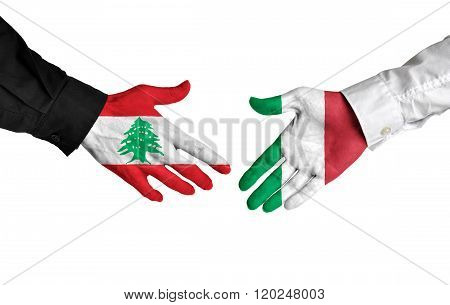 Lebanon and Italy leaders shaking hands on a deal agreement