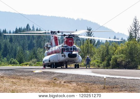 Chinook Helicopter And Fire Crew