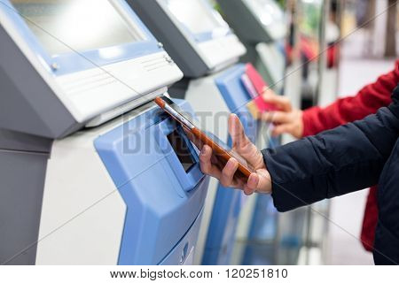 Woman using cellphone for paying her ticket
