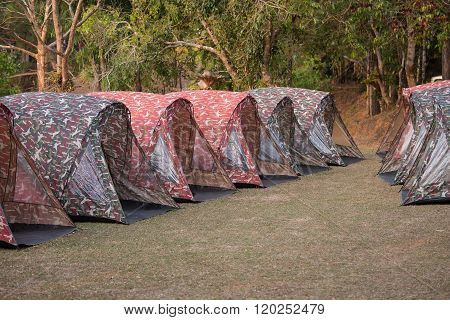 Tents on a hills at sunrise at Taksin Maharach National Park Tak,Thailand.