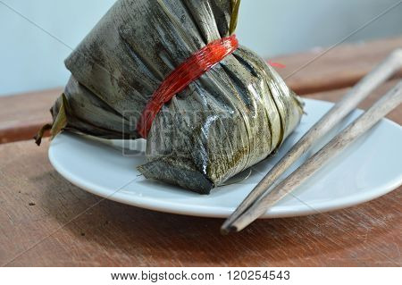 sticky rice steam with pork and salt egg in banana leaf of Chinese Duanwu festival