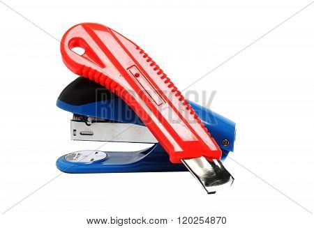 Office Stapler And Stationery Knife On A White Background