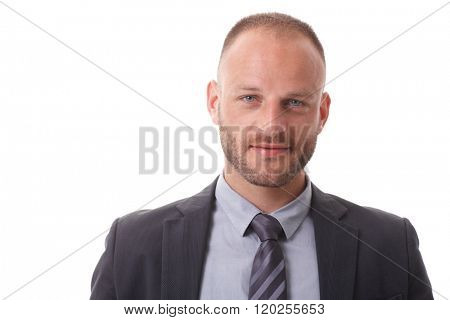 Closeup portrait of handsome businessman with small smile and blue eyes.