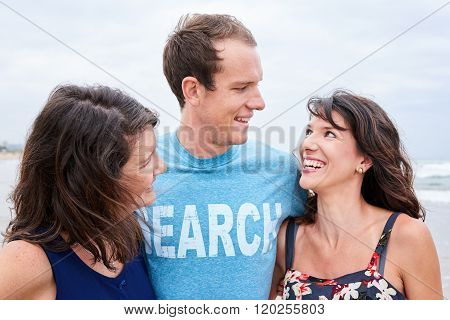 three siblings laughing and smiling at each other