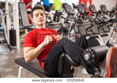 Handsome Man Doing Crunches In A Gym