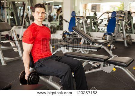 Hispanic Man Lifting Weights At The Gym