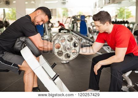 Male Friends Working Out At The Gym