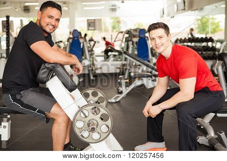 Men Lifting Some Weights At The Gym