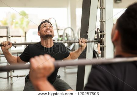 Using A Squat Machine At The Gym