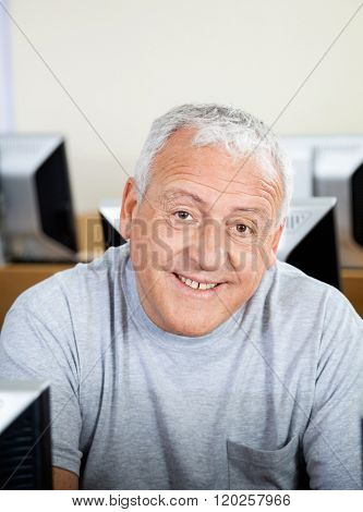 Happy Senior Man In Computer Class
