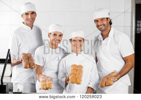 Baker's Showing Packed Breads In Bakery