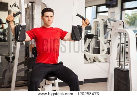 Working Out On Pec Deck Machine