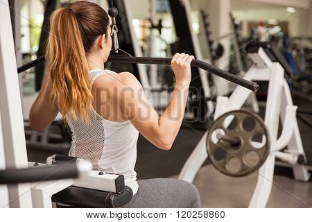 Strong Woman On A Lat Pulldown Machine